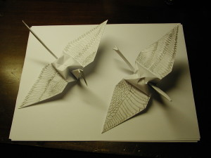 These are my original hand decorated origami cranes. Each wing is a different design.